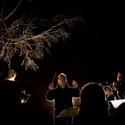 Christmas Carols, band conductor